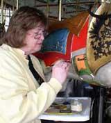 Linda McDonald restoring carousel